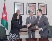 Jordan's Minister of Planning and International Cooperation Imad Fakhoury and British International Development Secretary Priti Patel during the signing ceremony