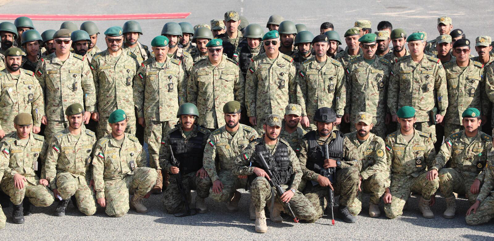 Kuwait National Guard (KNG) Undersecretary Lt. Gen. Hashem Al-Rifae with 32nd foundational training course trainees