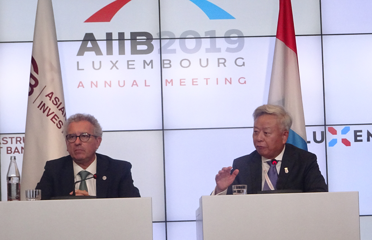 President of AIIB Jin Liqun and Luxembourg finance minister speaking at the press
